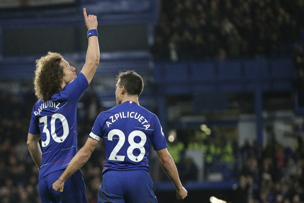 Chelsea's David Luiz, left, celebrates with his teammate Chelsea's Cesar Azpilicueta after scoring his side's second goal during the English Premier L