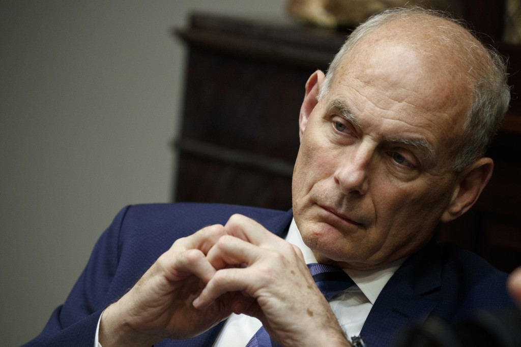 In this June 21, 2018 photo, White House chief of staff John Kelly listens as President Donald Trump speaks during a lunch with governors in the Roose