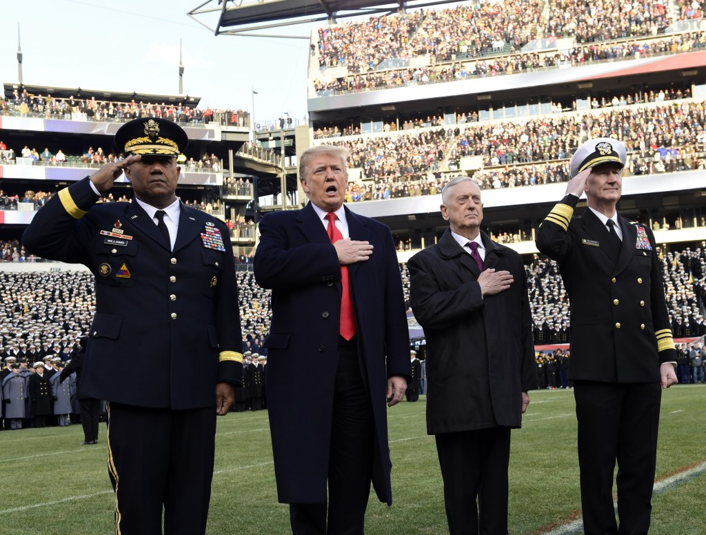 President Donald Trump, second from left, is joined by, from left, West Point Superintendent Lt. Gen. Darryl A. Williams, Defense Secretary Jim Mattis
