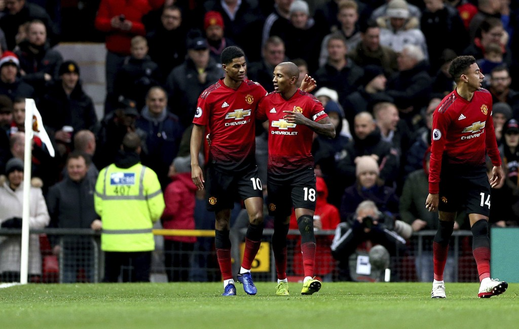 Manchester United's Ashley Young, center right, celebrates scoring his side's first goal of the game with teammate Marcus Rashford during their Englis