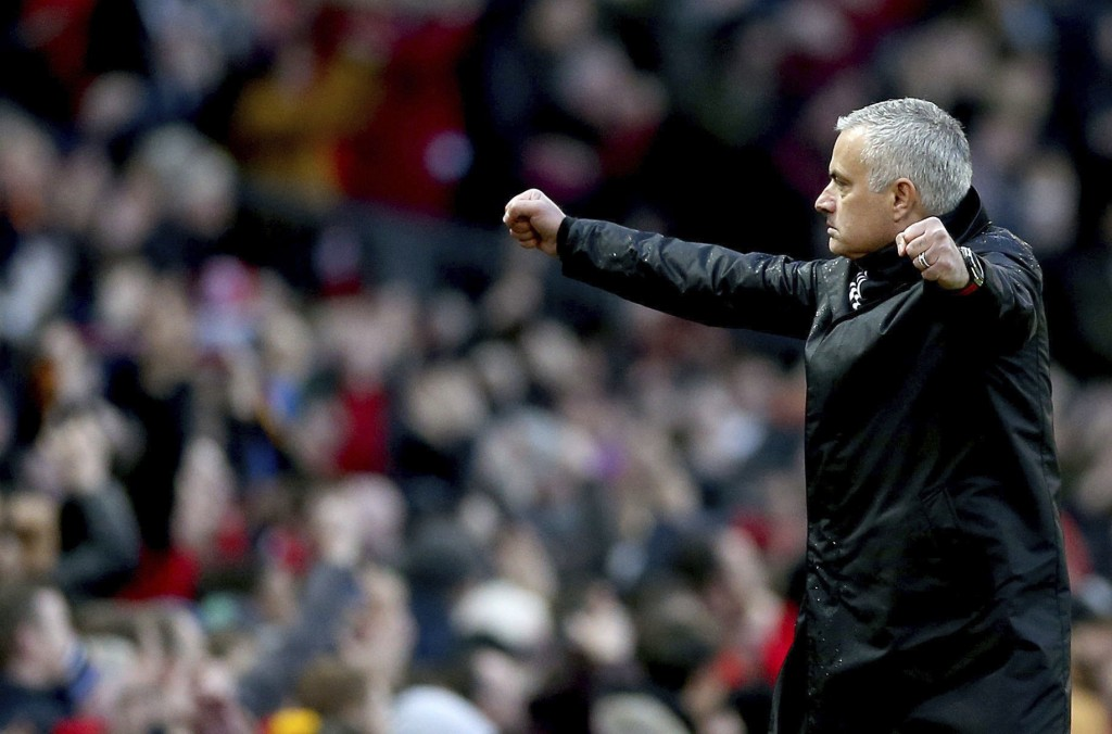 Manchester United manager Jose Mourinho celebrates after Juan Mata scores his side's second goal of the game during their English Premier League socce