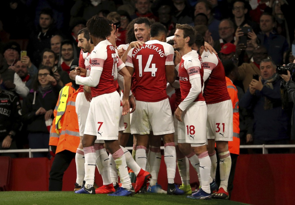 Arsenal's Lucas Torreira celebrates scoring his side's first goal of the game with his teammates, during the English Premier League soccer match betwe