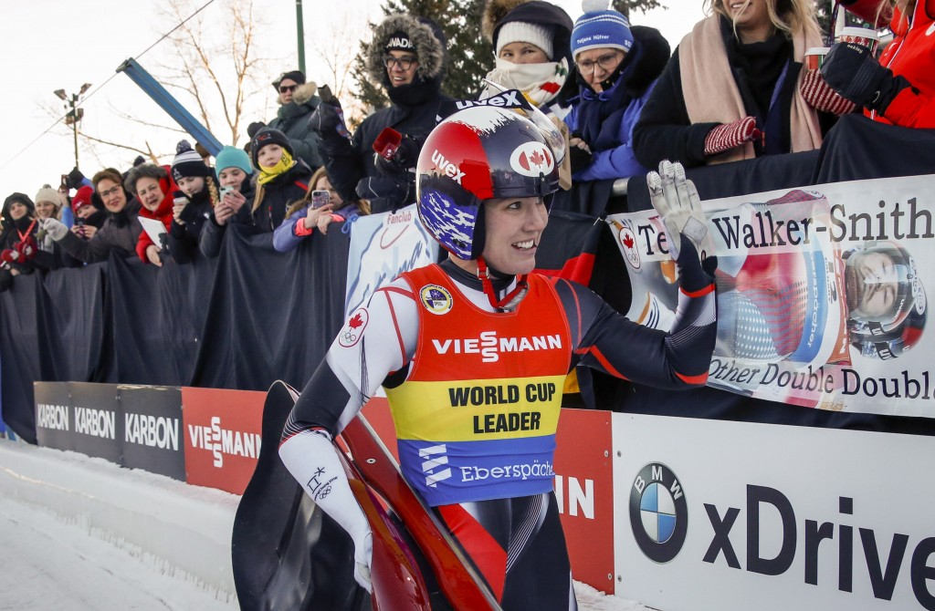 Canada's Alex Gough celebrates after taking her last run after announcing her retirement from the sport of luge during the women's World Cup luge comp