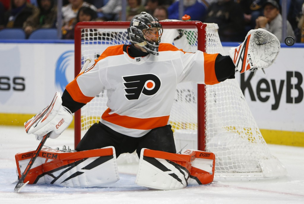 Philadelphia Flyers goalie Anthony Stolarz (41) reaches for the puck during the first period of an hockey game against the Buffalo Sabres, Saturday, D