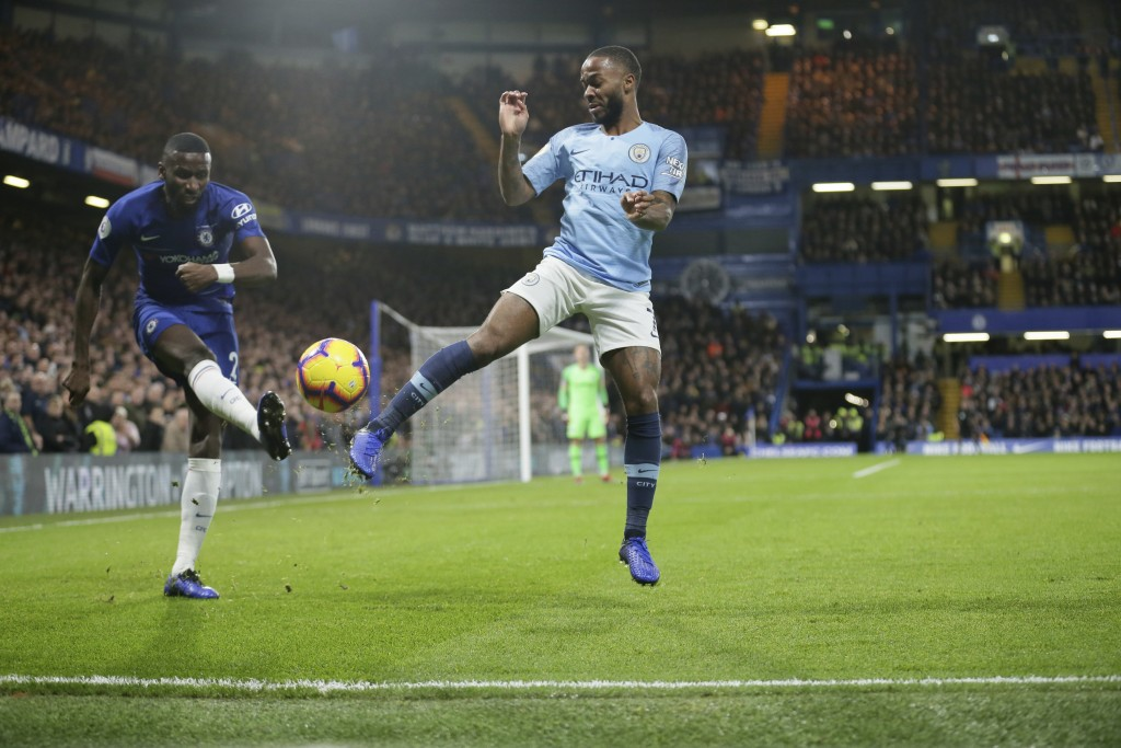 Chelsea's Antonio Rudiger, left, and Manchester City's Raheem Sterling compete for the ball during the English Premier League soccer match between Che