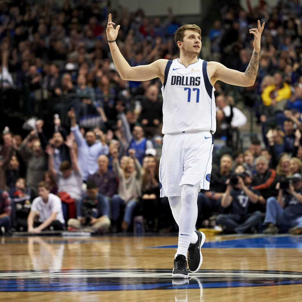 Dallas Mavericks forward Luka Doncic (77) reacts after making a 3-pointer against the Houston Rockets during the second half of an NBA basketball game...