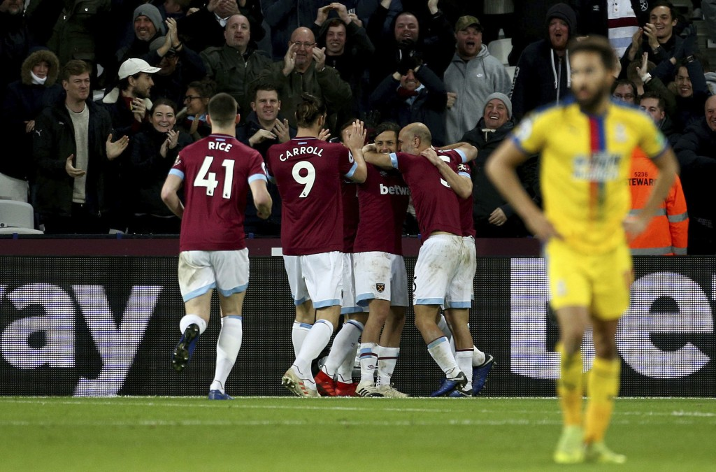 West Ham United's Robert Snodgrass, obscured, celebrates scoring his side's first goal of the game during their English Premier League soccer match ag