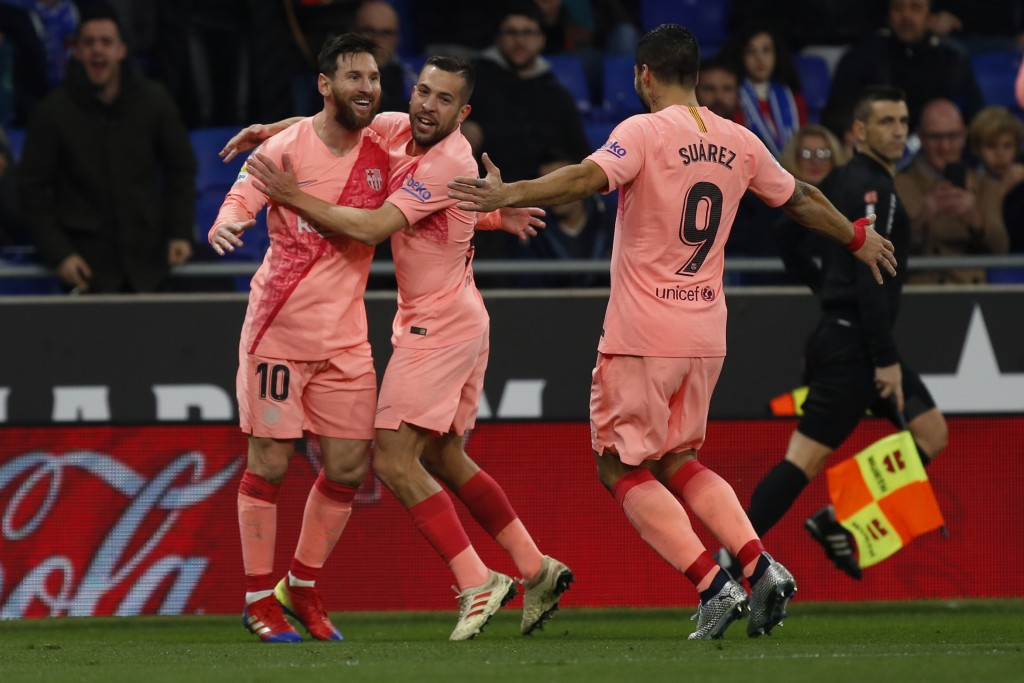 FC Barcelona's Lionel Messi, left,  celebrates with teammates during the Spanish La Liga soccer match between Espanyol and FC Barcelona at RCDE stadiu