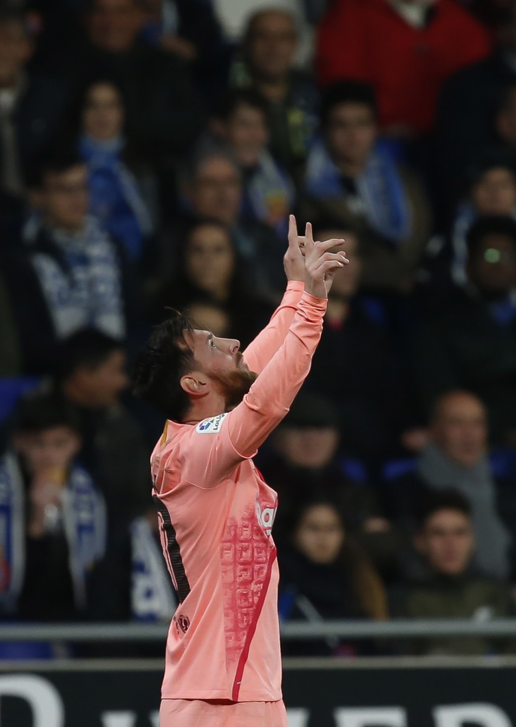 FC Barcelona's Lionel Messi celebrates during the Spanish La Liga soccer match between Espanyol and FC Barcelona at RCDE stadium in Cornella Llobregat