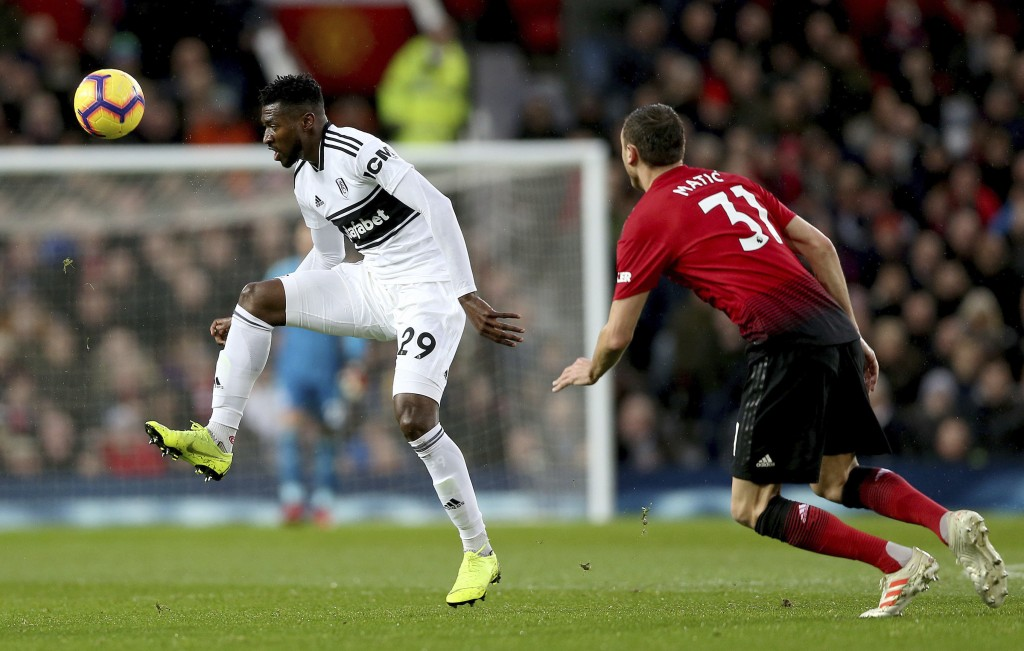 Fulham's Andre-Frank Zambo Anguissa, left, and Manchester United's Nemanja Matic in action during their English Premier League soccer match at Old Tra