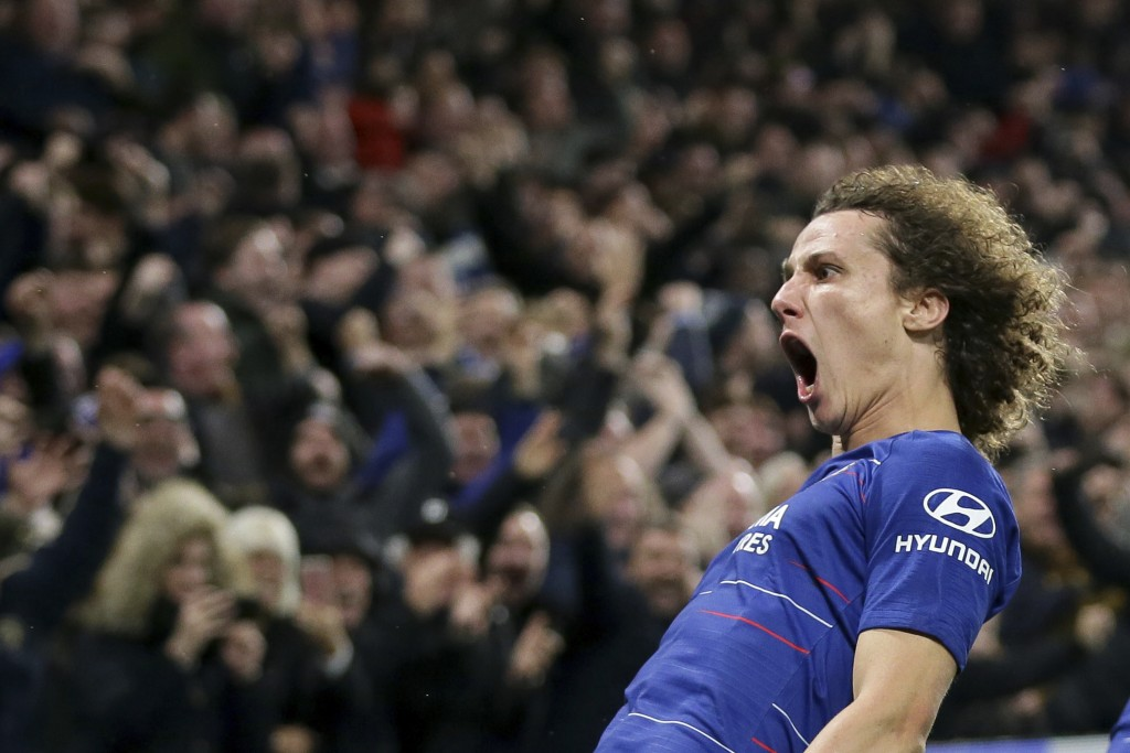 Chelsea's David Luiz, left, celebrates after scoring his side's second goal during the English Premier League soccer match between Chelsea and Manches