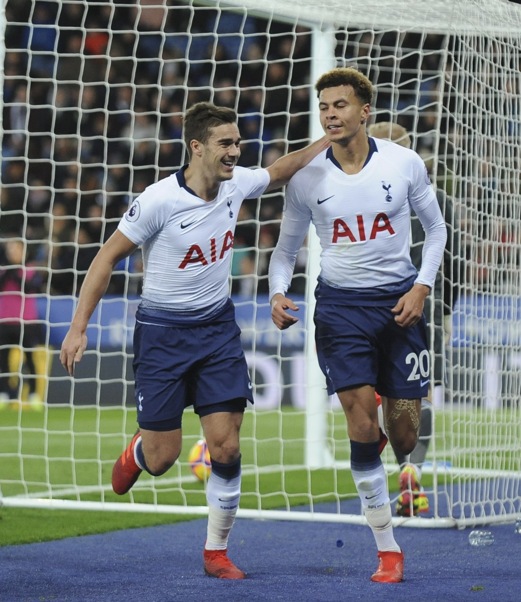 Tottenham's Dele Alli, right, celebrates after scoring their side's second goal with Tottenham's Harry Winks during the English Premier League soccer