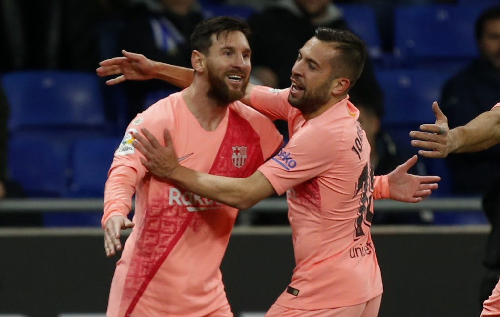 FC Barcelona's Lionel Messi, left,  celebrates with a teammate during the Spanish La Liga soccer match between Espanyol and FC Barcelona at RCDE stadi