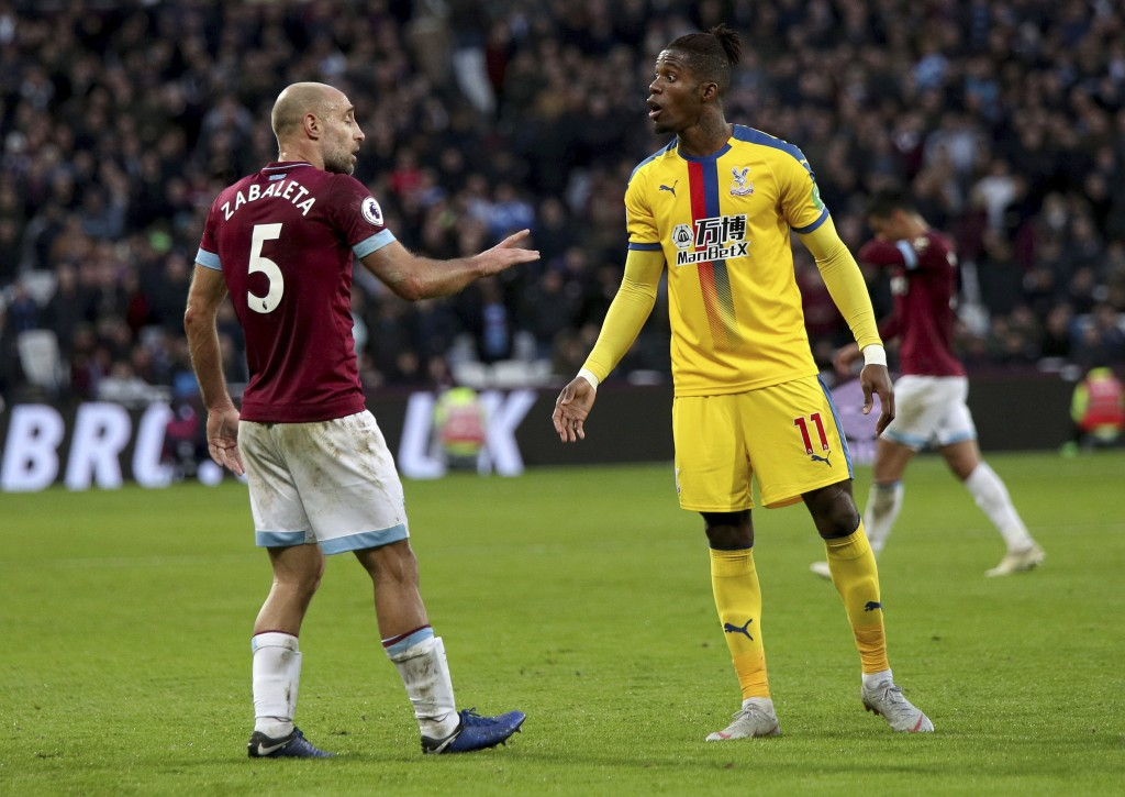 West Ham United's Pablo Zabaleta, left, and Crystal Palace's Wilfried Zaha exchange words during their English Premier League soccer match at The Lond