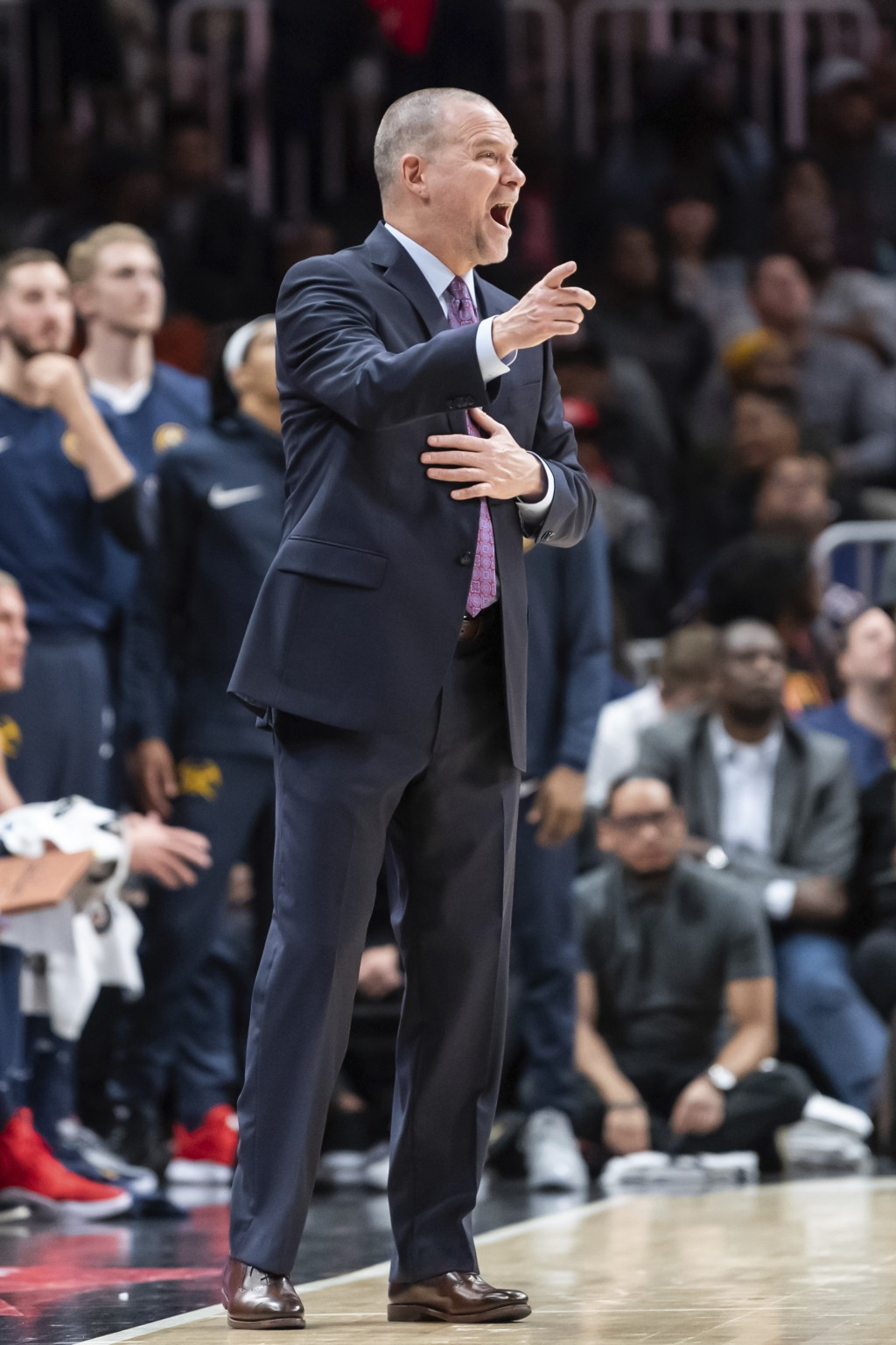 Denver Nuggets head coach Michael Malone directs his team during the second half of an NBA basketball game against the Atlanta Hawks Saturday, Dec. 8,