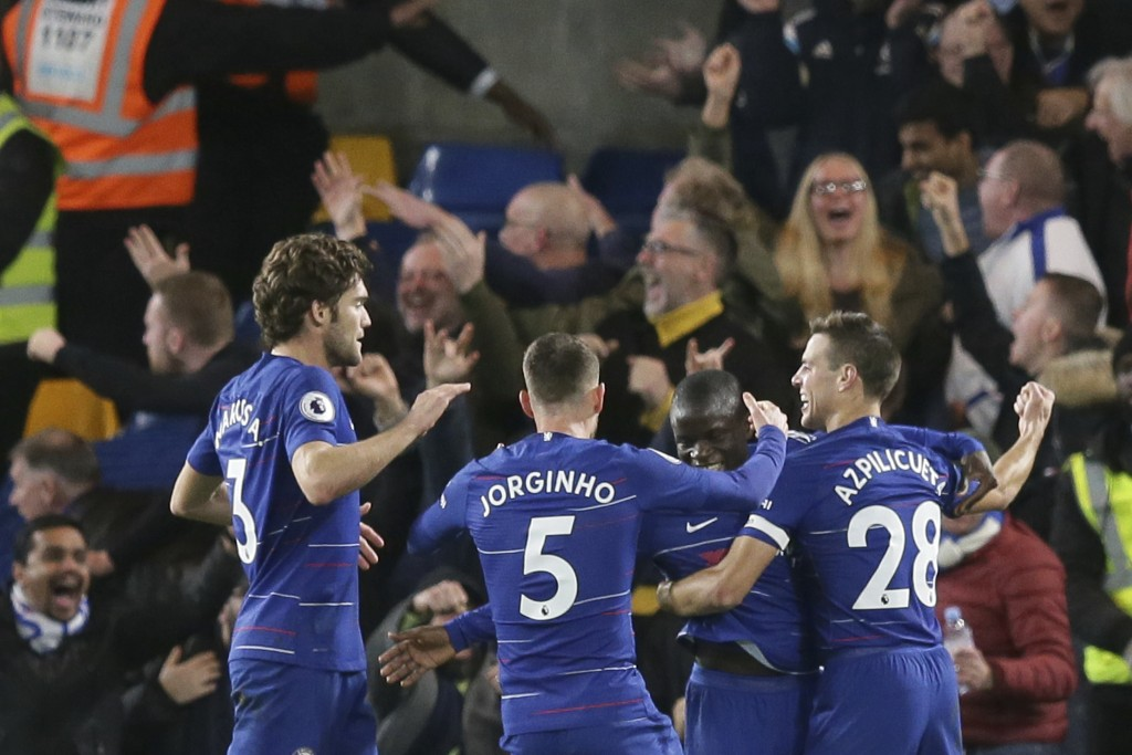 Chelsea's Ngolo Kante, second right, celebrates after scoring the opening goal with his teammates during the English Premier League soccer match betwe
