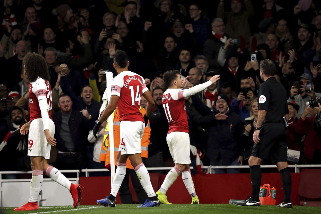 Arsenal's Lucas Torreira, centre left, celebrates scoring his side's first goal of the game, during the English Premier League soccer match between Ar