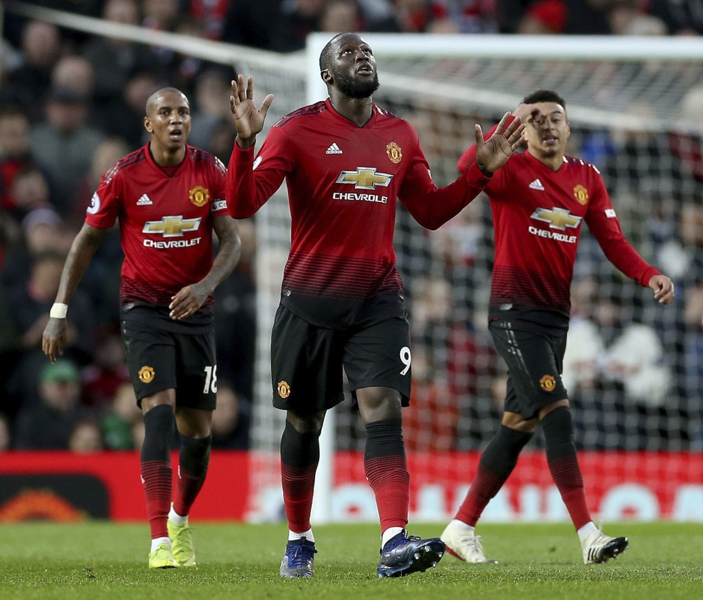 Manchester United's Romelu Lukaku, center, celebrates scoring his side's third goal of the game during their English Premier League soccer match again
