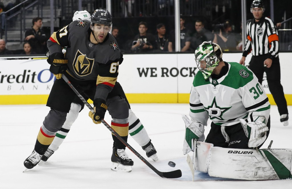 Vegas Golden Knights left wing Max Pacioretty (67) tries to tip the puck past Dallas Stars goaltender Ben Bishop (30) during the second period of an N...