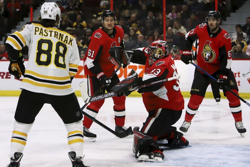 Boston Bruins right wing David Pastrnak (88) looks on as Ottawa Senators goaltender Mike McKenna (33) makes a blocker save during first-period NHL hoc...
