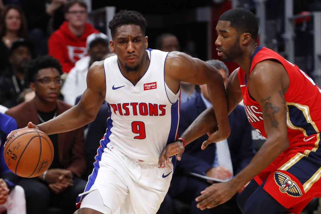 Detroit Pistons guard Langston Galloway (9) drives against New Orleans Pelicans guard E'Twaun Moore (55) in the first half of an NBA basketball game i