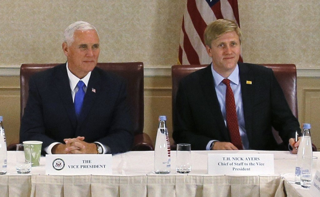 FILE - In this Aug. 1, 2017 file photo, Vice President Mike Pence, left, attends a meeting with Georgia opposition leaders in Tbilisi, Georgia. Chief ...