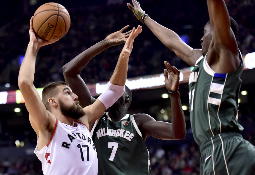 Toronto Raptors centre Jonas Valanciunas (17) drives to the net as Milwaukee Bucks forward Thon Maker (7) and teammates defend during second half NBA