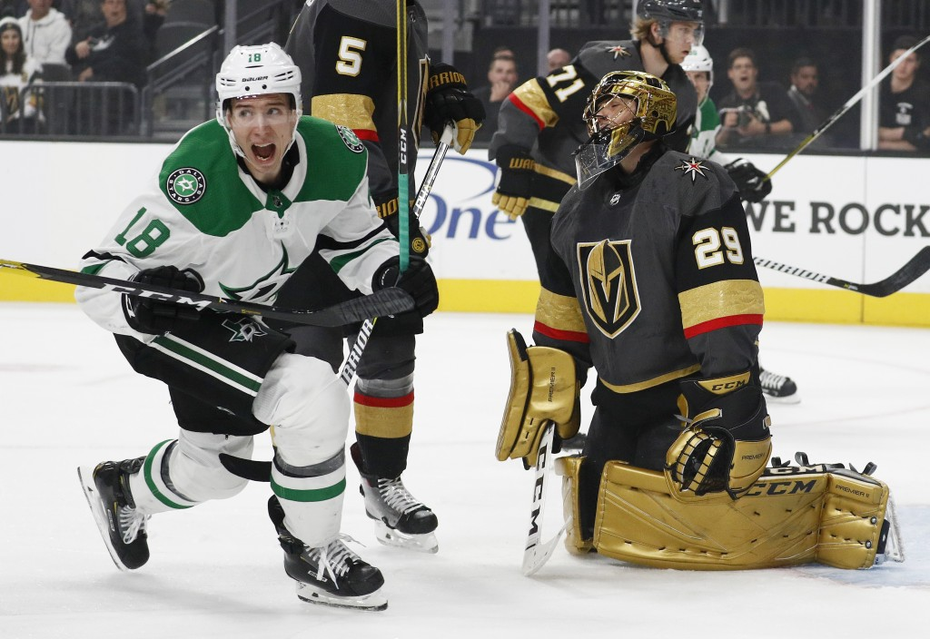 Dallas Stars center Tyler Pitlick (18) reacts after a teammate scored against Vegas Golden Knights goaltender Marc-Andre Fleury, right, during the fir...