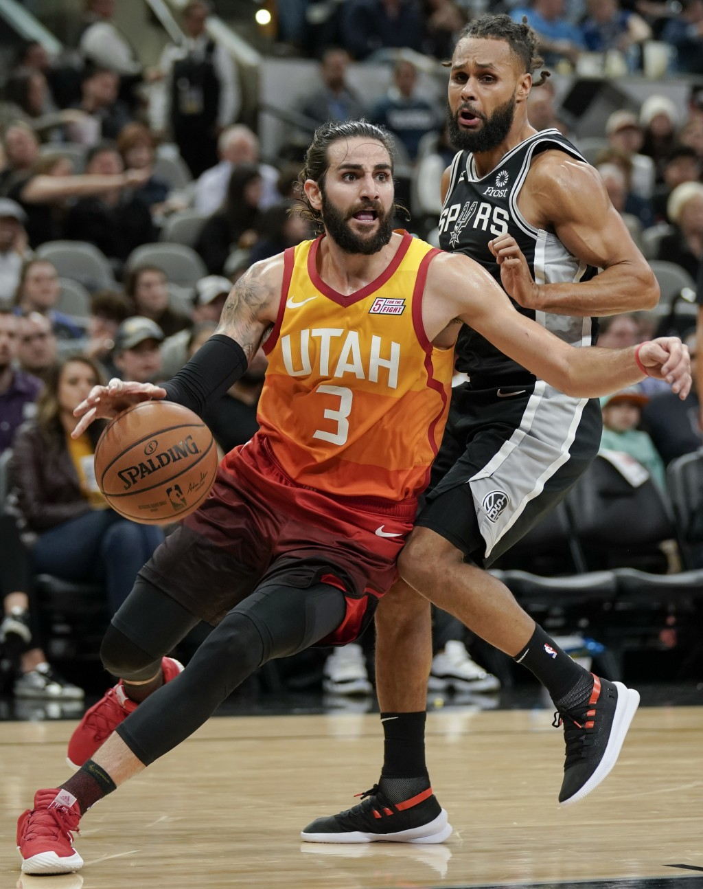 Utah Jazz guard Ricky Rubio (3) drives around San Antonio Spurs guard Patty Mills during the second half of an NBA basketball game, Sunday, Dec. 9, 20
