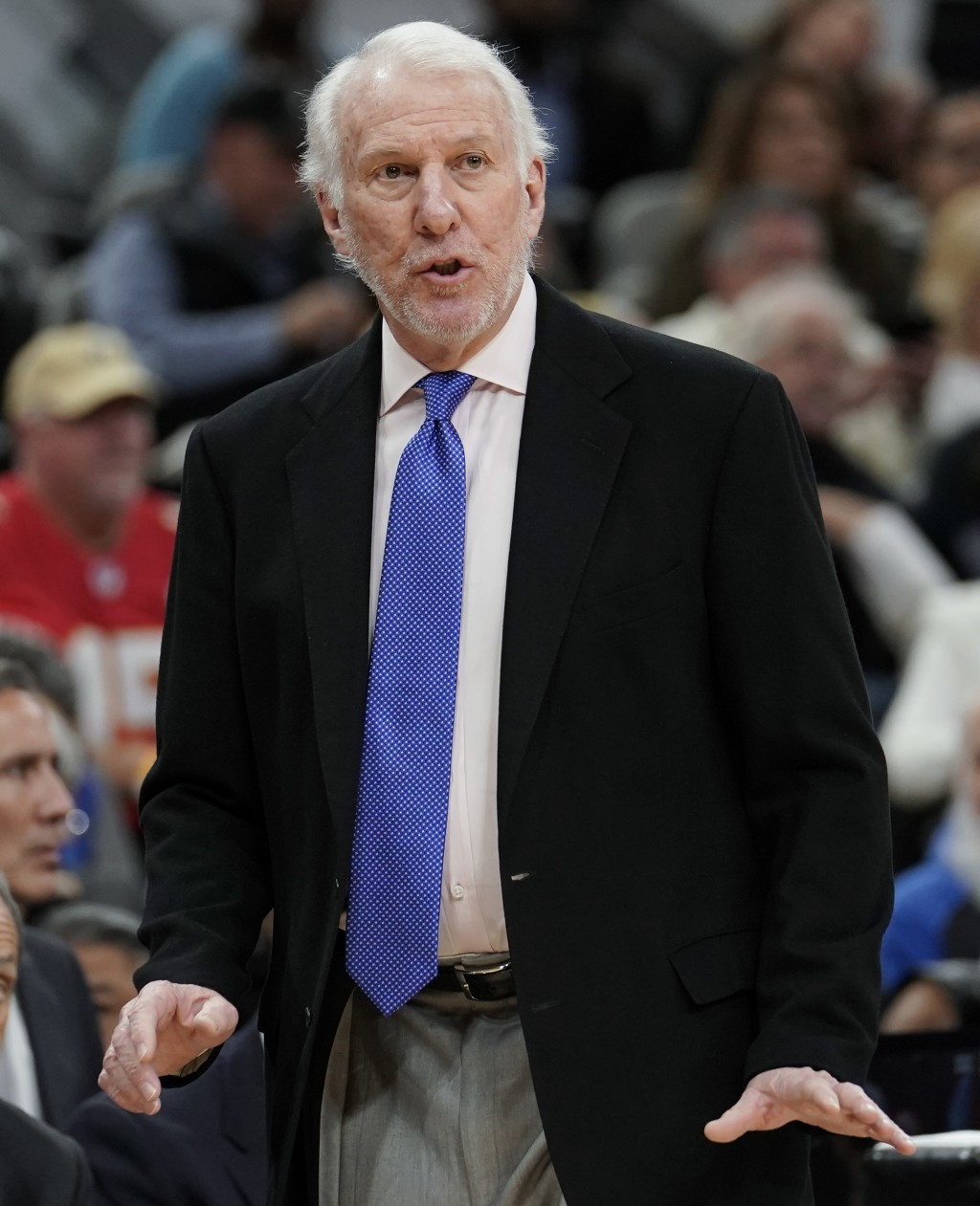 San Antonio Spurs head coach Gregg Popovich signals to his players during the first half of an NBA basketball game against the Utah Jazz, Sunday, Dec....