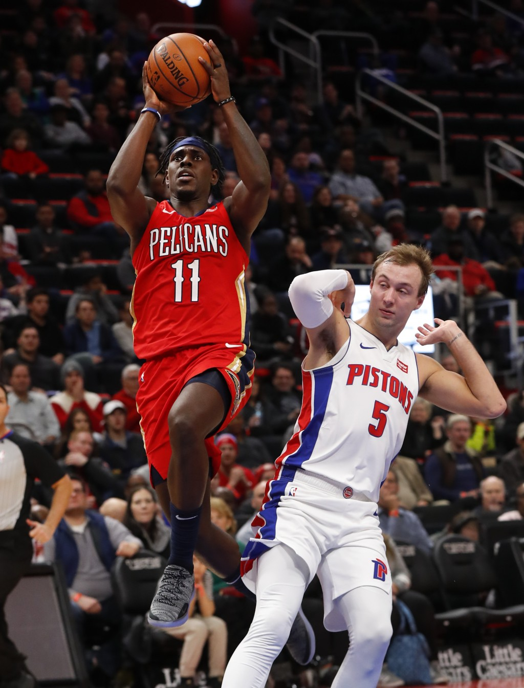 New Orleans Pelicans guard Jrue Holiday (11) drives against Detroit Pistons guard Luke Kennard (5) in the second half of an NBA basketball game in Det...