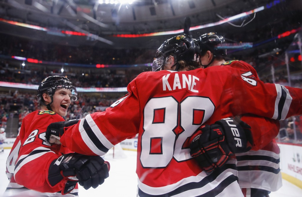 Chicago Blackhawks right wing Patrick Kane (88) celebrates with teammates after scoring against the Montreal Canadiens during the second period of an ...