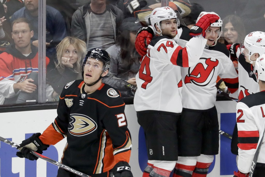 New Jersey Devils left wing Brett Seney, right, celebrates after scoring with defenseman Egor Yakovlev (74) during the second period of an NHL hockey ...
