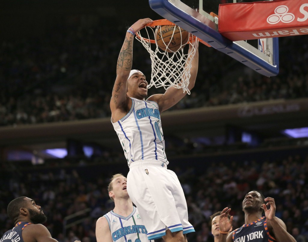 Charlotte Hornets' Miles Bridges dunks the ball during the first half of the NBA basketball game against the New York Knicks, Sunday, Dec. 9, 2018, in...