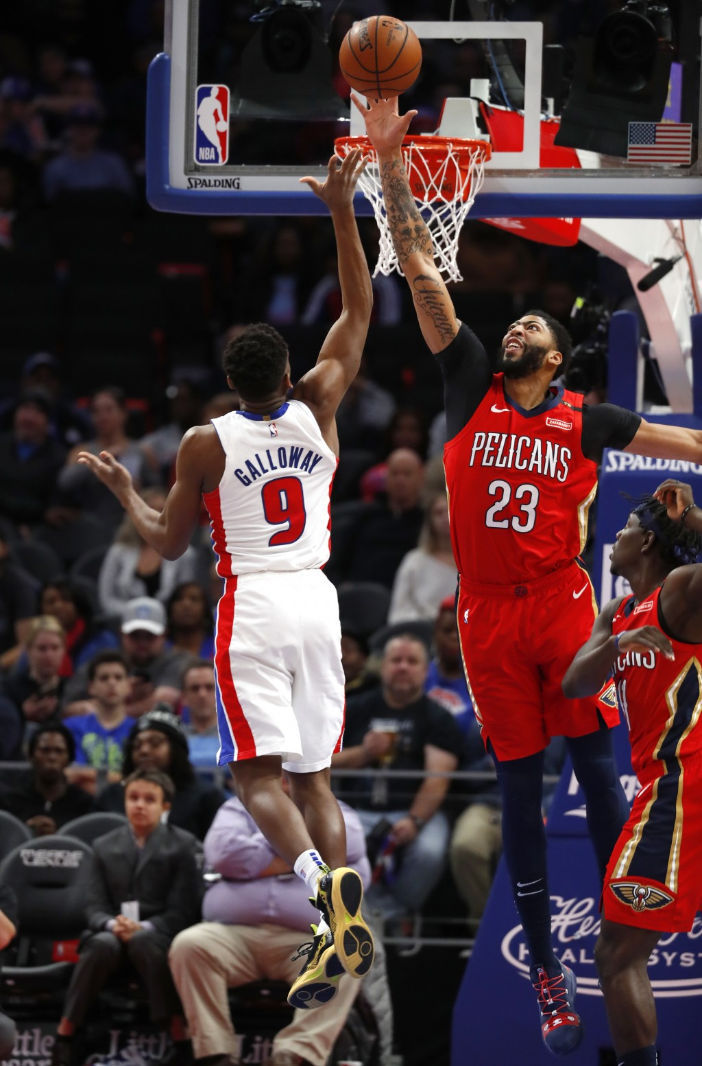 New Orleans Pelicans forward Anthony Davis (23) blocks a shot byDetroit Pistons guard Langston Galloway (9) in the second half of an NBA basketball ga...