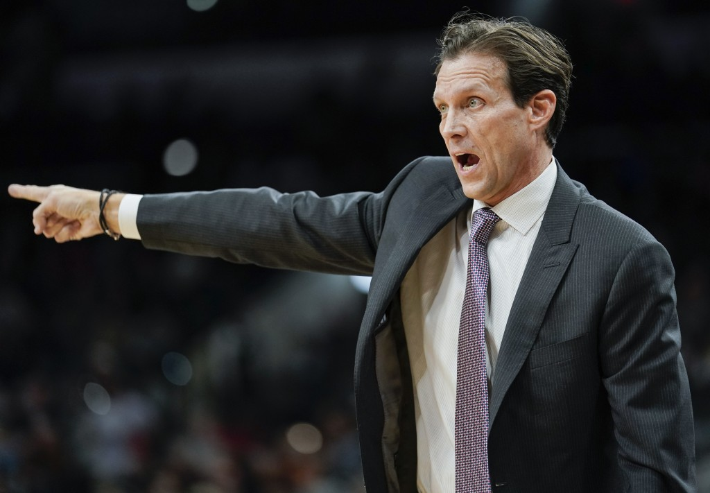 Utah Jazz head coach Quin Snyder yells to his players during the first half of an NBA basketball game against the San Antonio Spurs, Sunday, Dec. 9, 2...