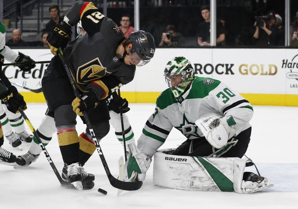 Dallas Stars goaltender Ben Bishop (30) blocks a shot by Vegas Golden Knights center Cody Eakin (21) during the second period of an NHL hockey game Su