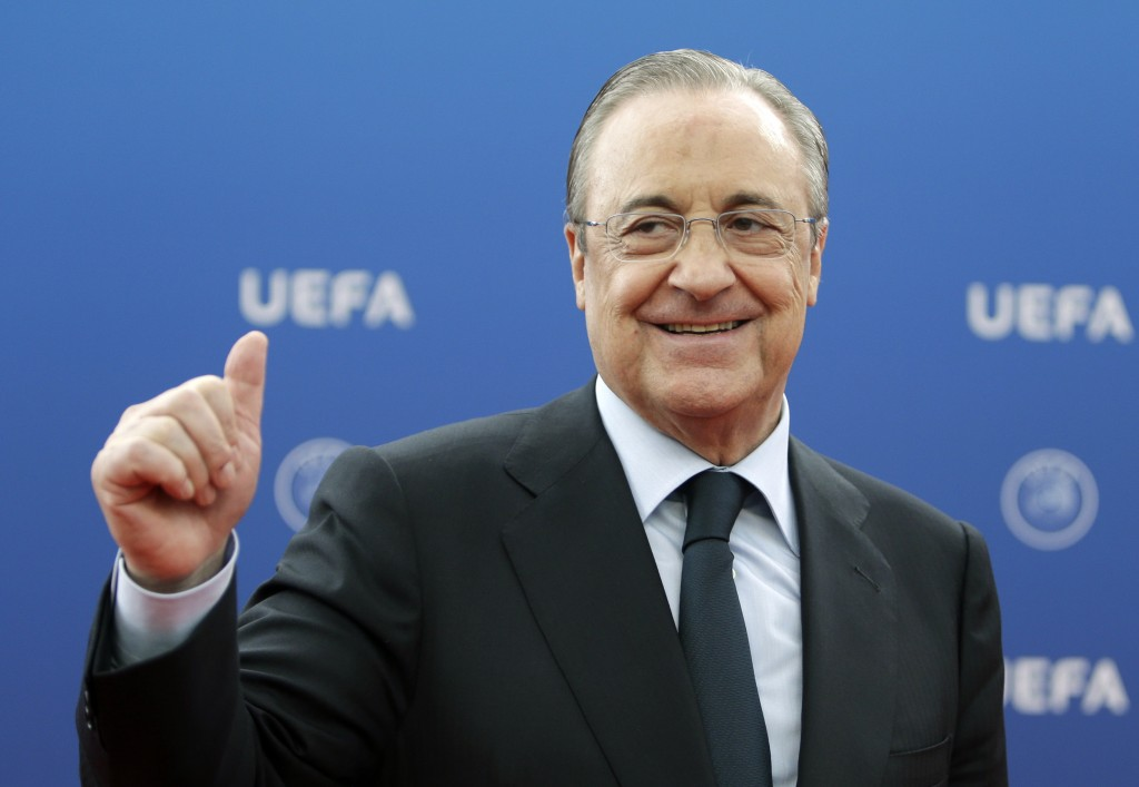 FILE - In this file photo dated Thursday, Aug. 30, 2018, Real Madrid President Florentino Perez gives a thumbs up as he arrives for the UEFA Champions...