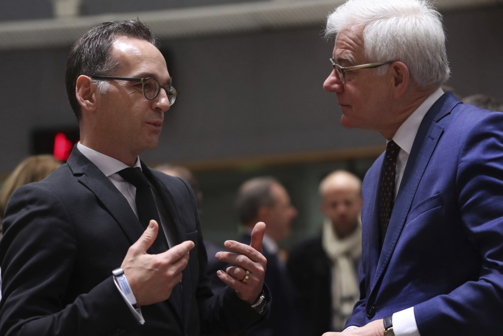 Germany's Foreign Minister Heiko Maas, left, talks to his Poland counterpart Jacek Czaputowicz prior a meeting of EU Foreign Affairs ministers at the ...