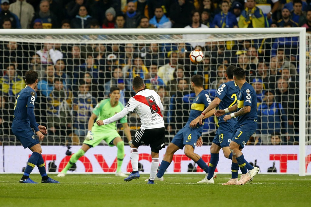 Juan Quintero of Argentina's River Plate, 8, scores his side's second goal against Argentina's Boca Juniors during extra time of the Copa Libertadores