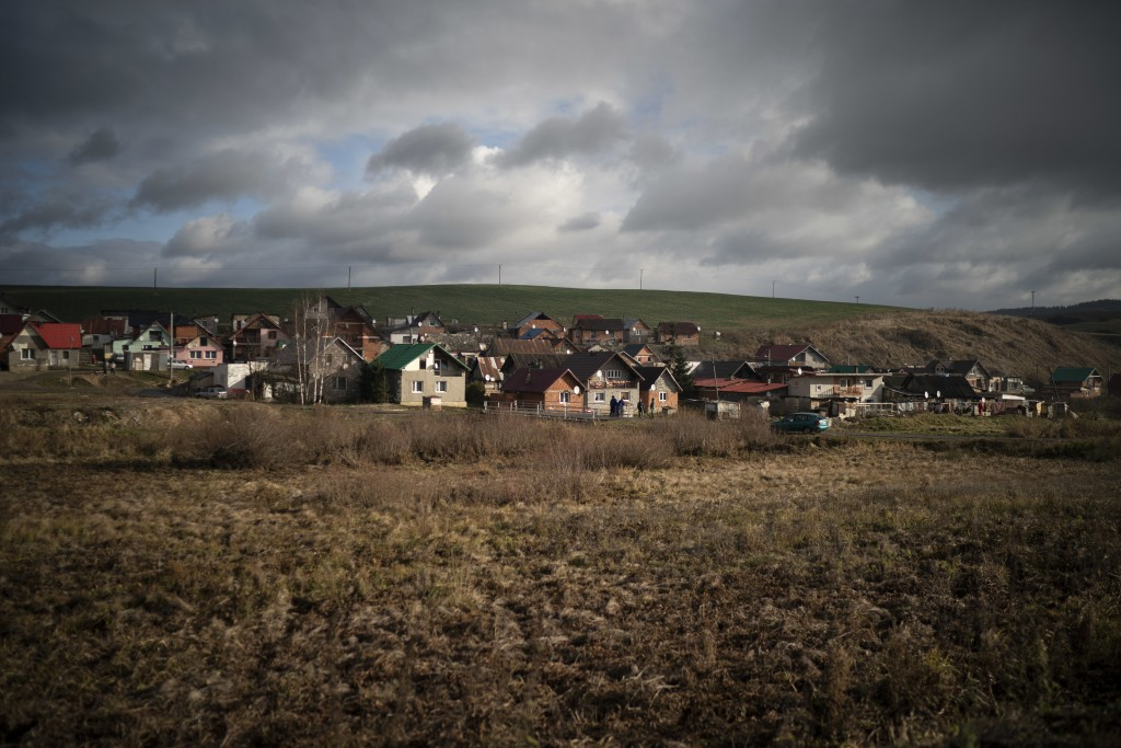 In this Nov. 14, 2018, photo, dark clouds hover over Podhorany village after a storm near Kezmarok, Slovakia. An investigation by The Associated Press...