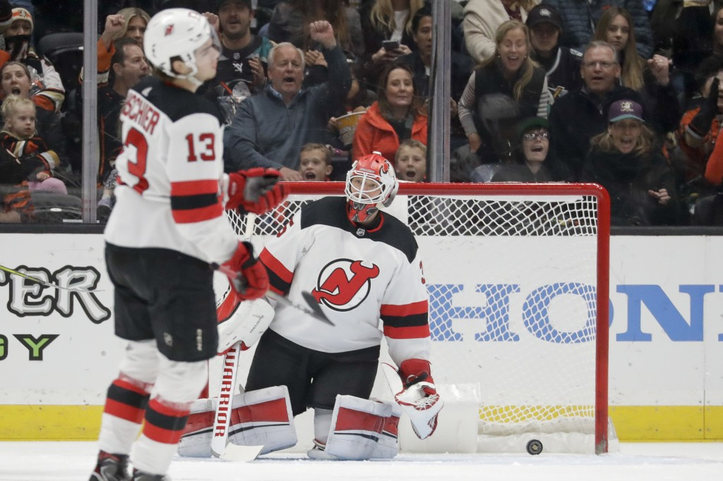 New Jersey Devils goaltender Cory Schneider and Nico Hischier react after a goal by Anaheim Ducks right wing Jakob Silfverberg during the first period