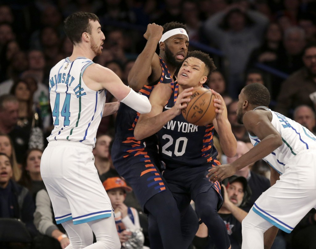 New York Knicks' Kevin Knox (20), center, fights for a rebound during the first half of the NBA basketball game against the Charlotte Hornets, Sunday,...