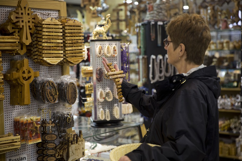 In this Thursday, Dec. 6, 2018 photo, a woman visits a shop near the Church of the Nativity, built atop the site where Christians believe Jesus Christ...