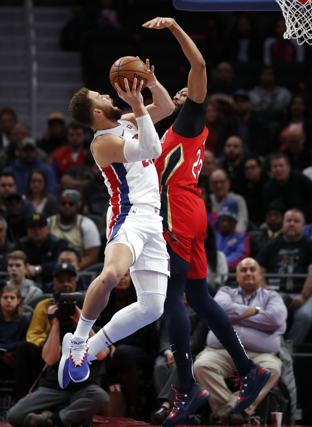 Detroit Pistons forward Blake Griffin (23) drives on New Orleans Pelicans forward Anthony Davis (23) in the second half of an NBA basketball game in D...