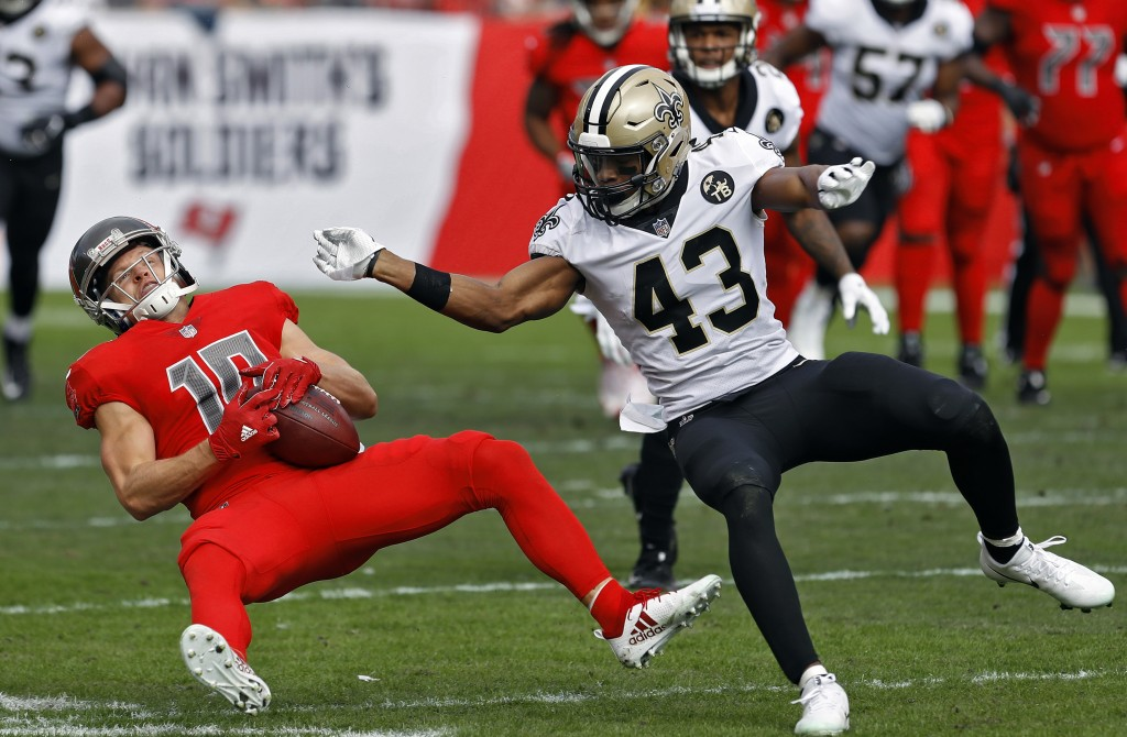 New Orleans Saints free safety Marcus Williams (43) levels Tampa Bay Buccaneers wide receiver Adam Humphries (10) after a reception during the first h...