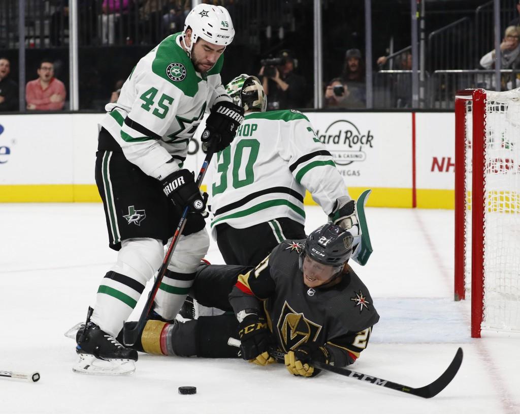 Vegas Golden Knights center Cody Eakin (21) falls after colliding with Dallas Stars goaltender Ben Bishop (30) as defenseman Roman Polak (45) knocks t