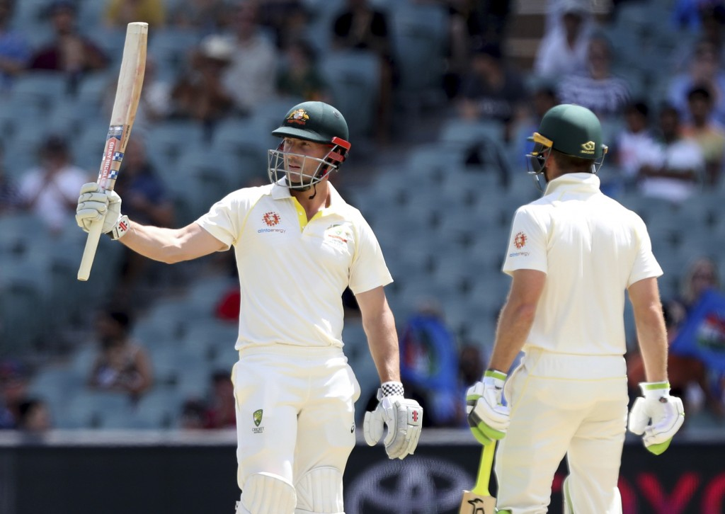 Australia's Shaun Marsh gestures with his bat after scoring a half century on the final day of the first cricket test between Australia and India in A...