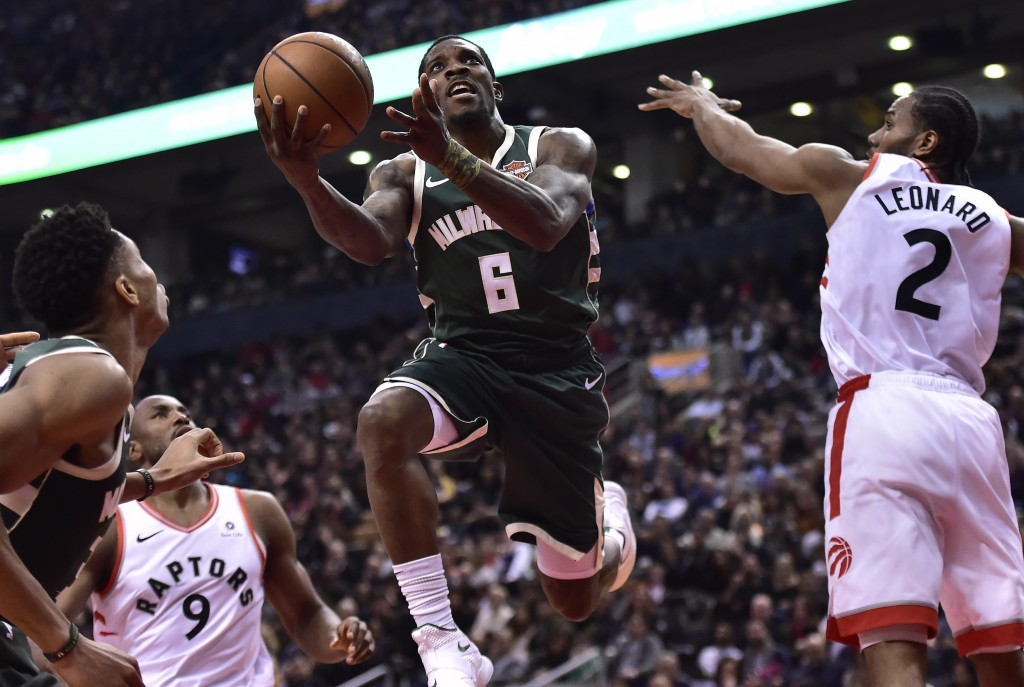 Milwaukee Bucks guard Eric Bledsoe (6) drives to the net as Toronto Raptors forward Kawhi Leonard (2) attempts to defend during first half NBA basketb...