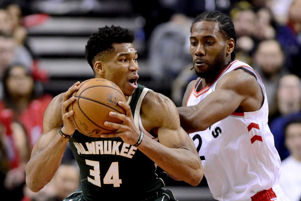 Toronto Raptors forward Kawhi Leonard (2) puts pressure on Milwaukee Bucks forward Giannis Antetokounmpo (34) as he looks for the pass during second h